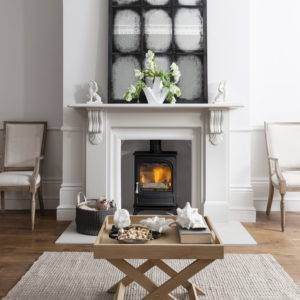 Arad Holborn in white fireplace