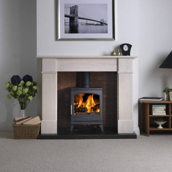 ashdale stove lit in stone fireplace