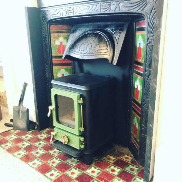 green and black hobbit stove