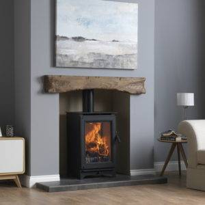 Icarus 5 in wooden mantle fireplace in black