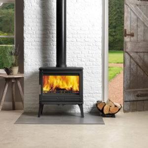 Larhcdale widescreen wood burner against brick wall