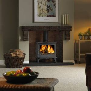 Rowandale 2 widescreen wood burner in brick fireplace
