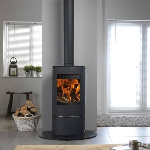 Solis round wood burner on black slate